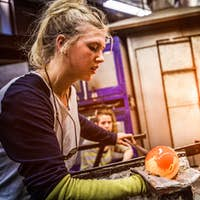 Two Women Shaping Blown Glass on the Blowpipe