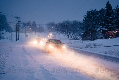 Blizzard on the Road during a Cold Winter Evening in Canada