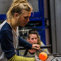 Two Women Shaping glass on the Blowpipe