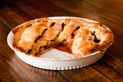 Freshly baked apple pie with a missing portion