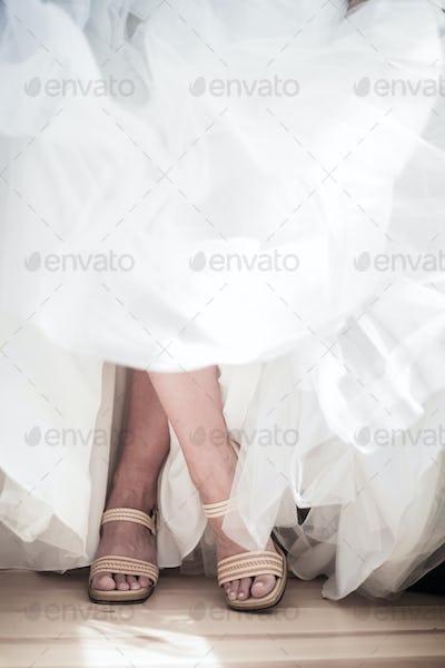 Crossed legs of a Bride