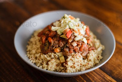 Vegan Dinner composed of Quinoa, Tomato sauce with Vegetables