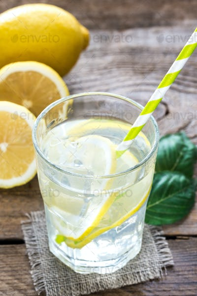 Glass of water with fresh lemon juice