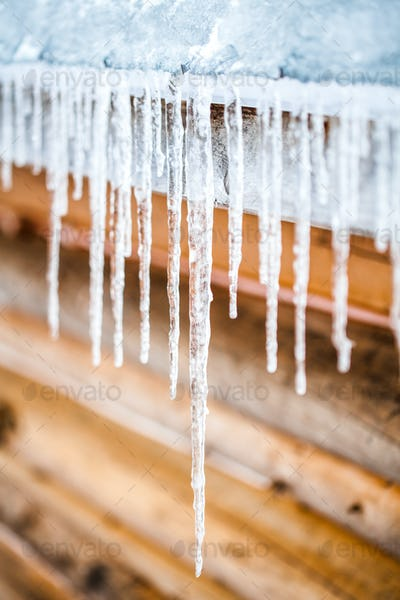 Long Icicles Melting of a roof top