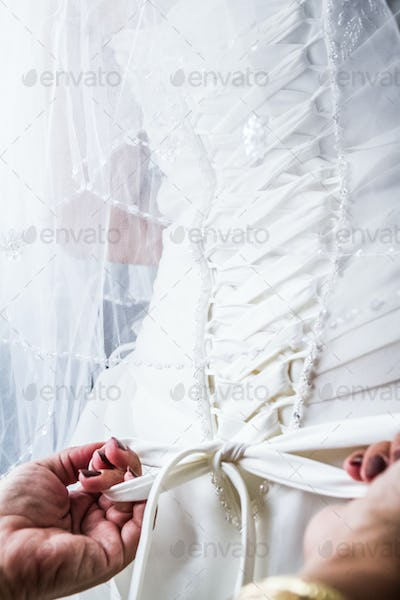 Mother Tying the Bride's Wedding dress