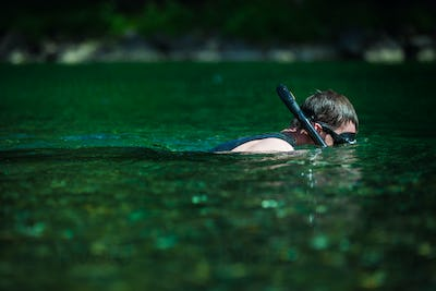 Young Adult Snorkeling in a river