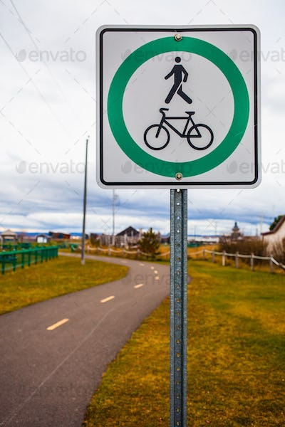 Bike and Pedestrian Path Sign and Blurry Track