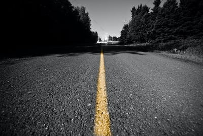 Empty road with Yellow Dividing line at Night