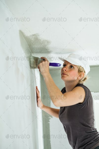 Woman Painting the Edges of the Ceiling