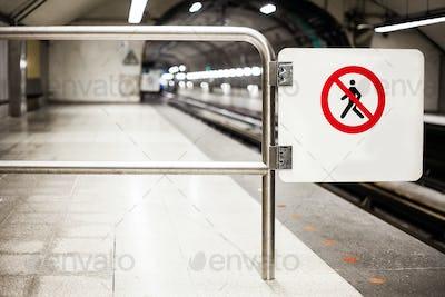 Safety Interdiction Sign (Do not Cross) on a Subway Platform