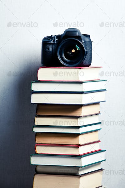 Camera on a stack of books
