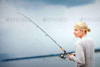 Young Woman Fishing Mackerel in Vacation