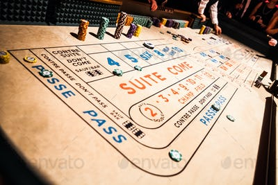 Craps Table and People Gambling all Around
