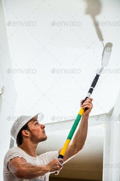Closeup of Man Painting the Ceiling