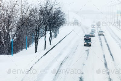 Traffic and Snowstorm on the Highway