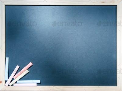 Close-up blackboard with chalks