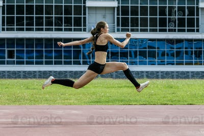 Young girl jumping triple jump
