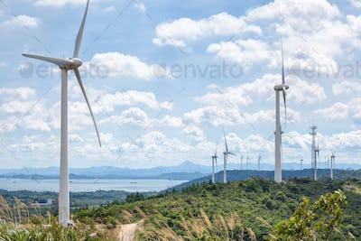 wind farm beside the lake