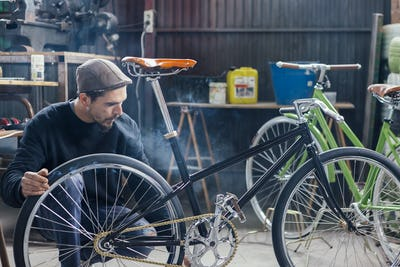 Craftsman looking at bicycle