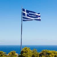 Greek biggest national flag waving in the sky in Keri in Zakynth
