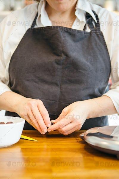 Woman peeling dates