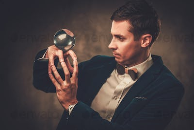 Young illusionist performing tricks on a stage