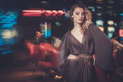 Beautiful woman in a luxury casino interior
