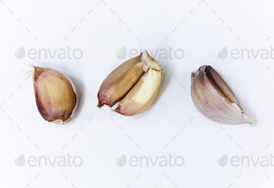 Closeup of garlic cloves on white background