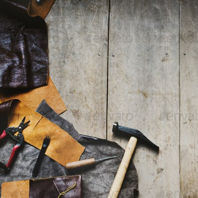 Aerial view of leather crafting with tools on wooden table