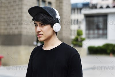 Asian Guy Listen to Music Headphones