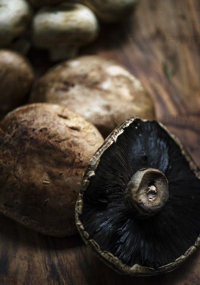 Closeup of portobello mushroom on wooden table