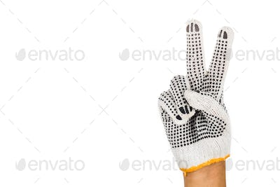 Hand in industrial glove gesturing number two against white back