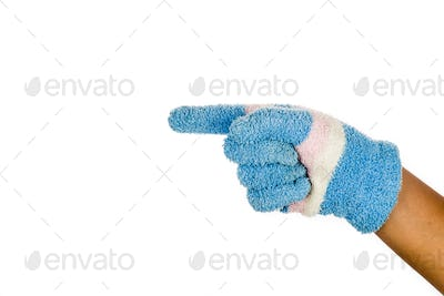 Hand in blue winter glove pointing direction against white backg