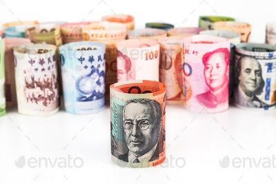Pile of rolled-up currency notes with Australian Dollar in front
