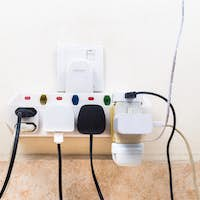 Multiple electricity plugs attached to multi adapter is dangerou