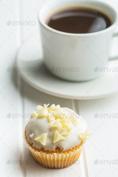 Tasty cupcake and coffee cup.