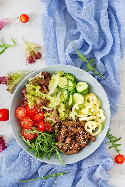 Salad with beef teriyaki and fresh vegetables