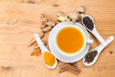 Healthy turmeric tea with black pepper, cinnamon, cloves and gin