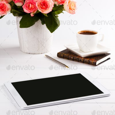 pink roses,notepad and tablet
