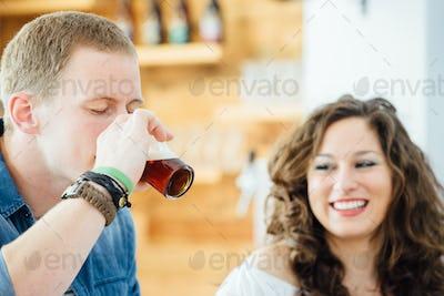 Man drinking dark beer