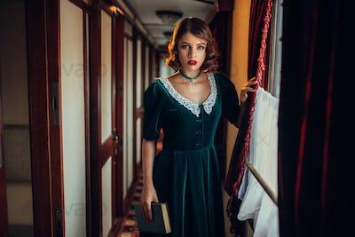 Old-fashioned woman travels, retro train