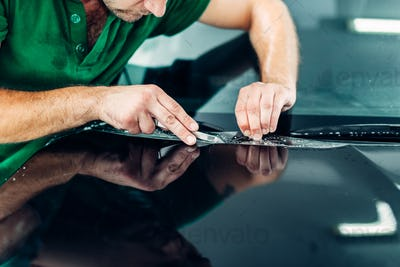 Professional worker install paint protect