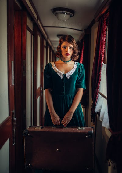 Woman with suitcase in retro train, rich interior