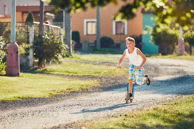 Boy with push scooter