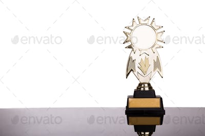 Gold medal trophy on white background
