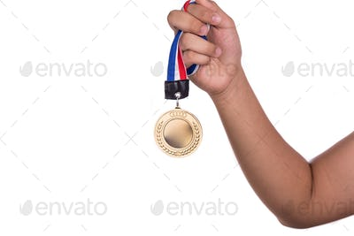 Athlete holding gold medal with ribbon with his hand