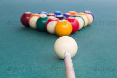 Focus on cue aiming white ball to break snooker billards