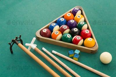 Snooker billards pool balls, cue, chalk on green table