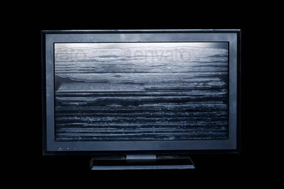Old television on black background