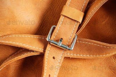 Sash and metal on leather